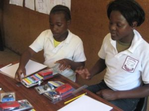 Sam Nzime Learners with new stationery