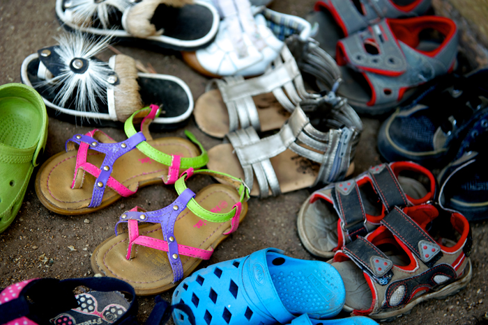 Children's Shoes outside the Creche - Ryan Graham