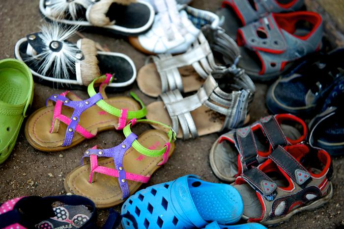 Children's Shoes outside the Creche - Ryan Graham