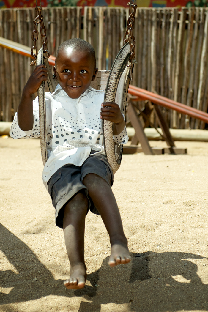 Londolozi Child playing on the swings - Ryan Graham