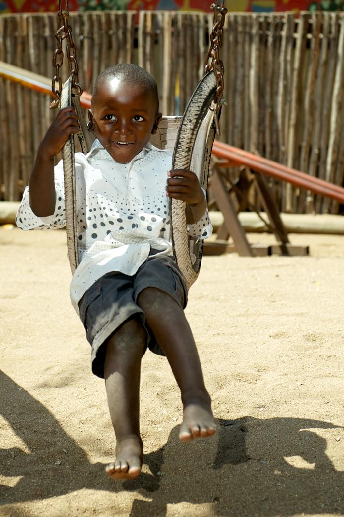 Londolozi Child playing on the swings - Ryan Graham