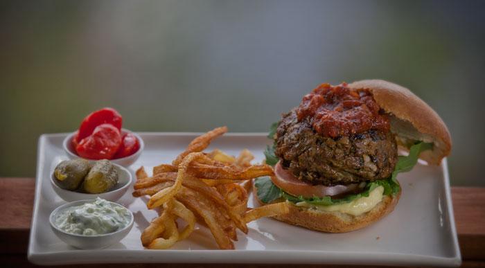 Londolozi Lamb Burger with minted Tzatziki, slow cooked tomato Sheeba and skinny fries
