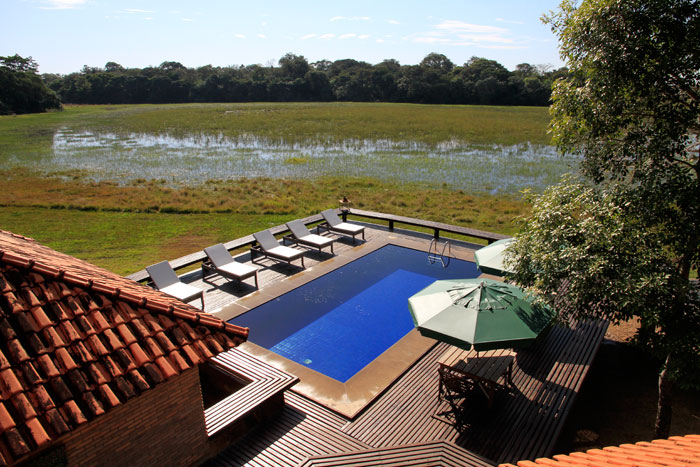 View of the deck and swimming pool at one of the two lodges at Caiman.