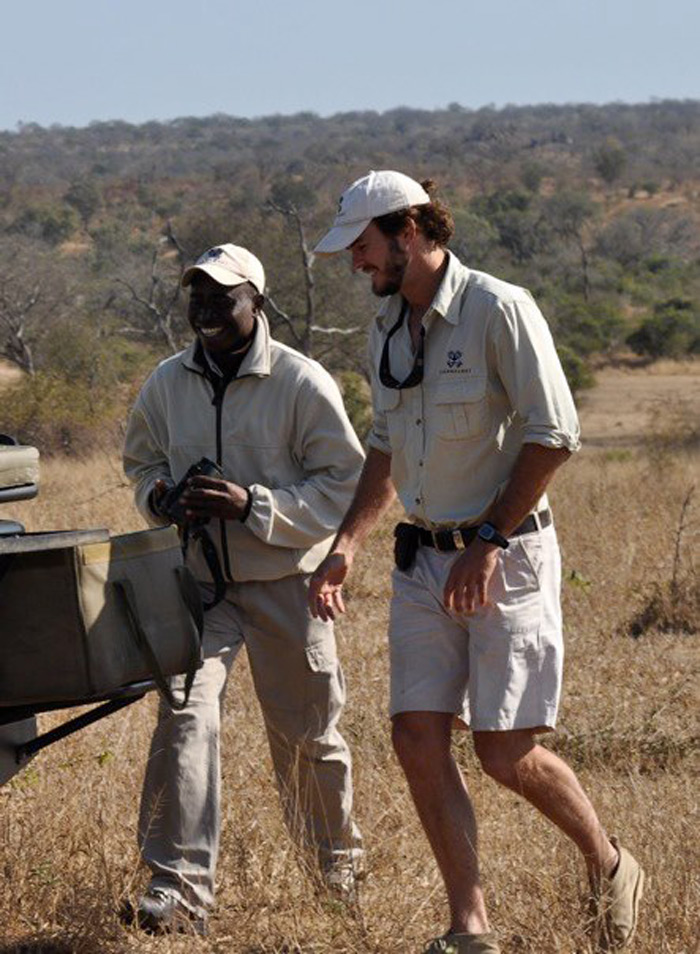 James and tracker Mike Sithole share a laugh over early morning coffee in the bush.