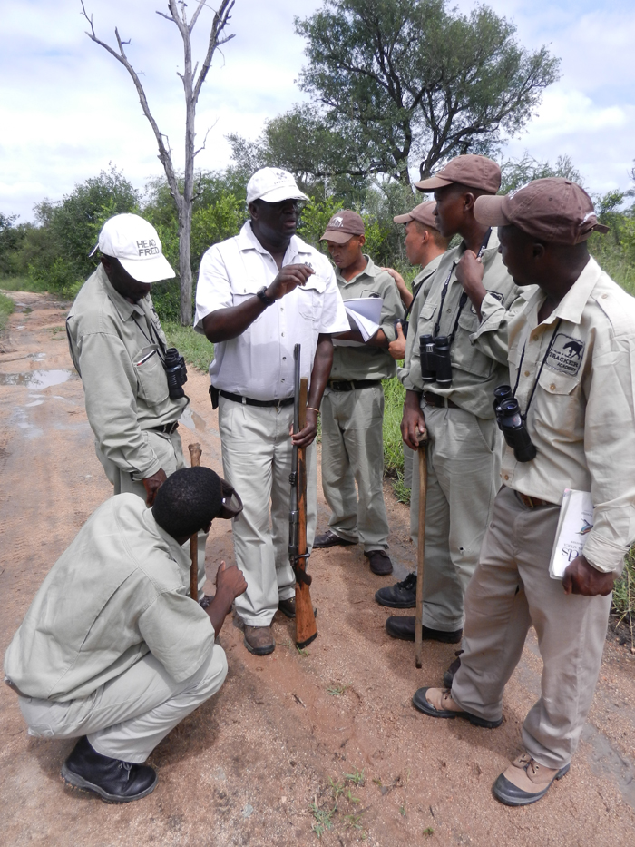 Renias giving a lesson on tracking leopards