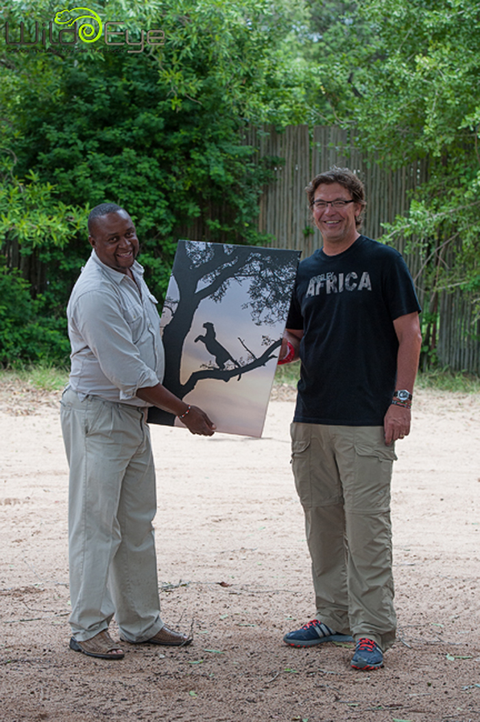 Life with Jono Buffey of Wild Eye presenting him with a canvas of one of his images.