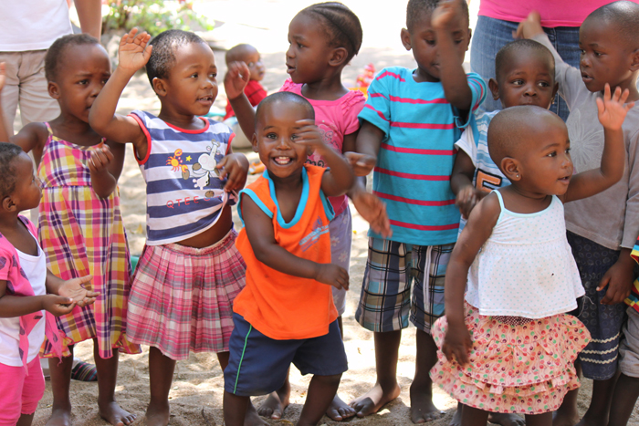 The children singing to the guests in the village!
