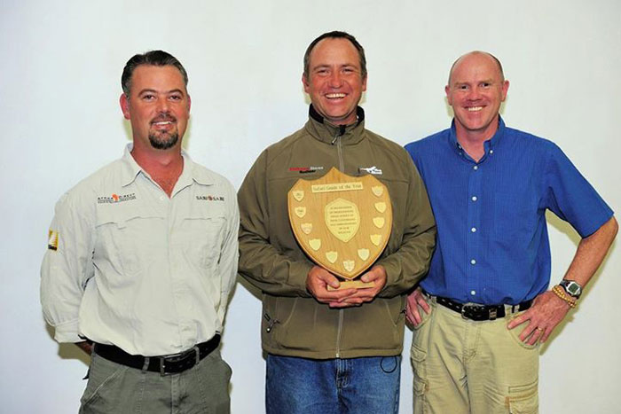 Tom receiving his trophy from head of FGASA Gerald Hinde (pictured right) and safari guide Mike Karantonis