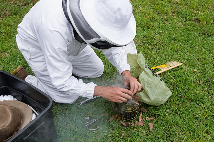 Chris Goodman preparing the smoker.