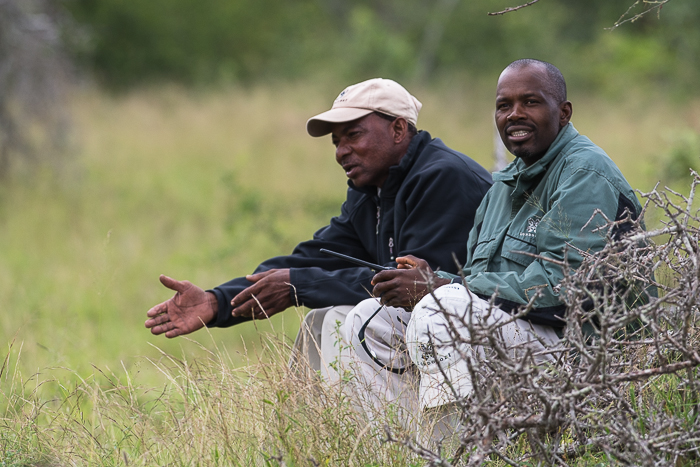 The men behind the sightings, two of Londolozi's trackers take a rest after tracking the Tamboti female and her cub.
