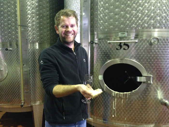 JD, the winemaker, showing us the lees.
