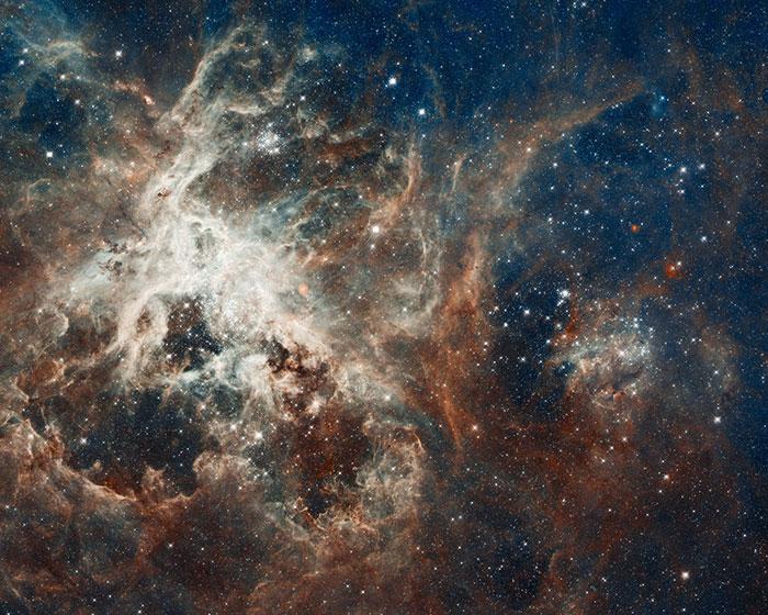 Hubble's Panoramic View of a Turbulent Star-making Region.  Image Courtesy of: NASA, ESA, D. Lennon and E. Sabbi (ESA/STScI), J. Anderson, S. E. de Mink, R. van der Marel, T. Sohn, and N. Walborn (STScI), N. Bastian (Excellence Cluster, Munich), L. Bedin (INAF, Padua), E. Bressert (ESO), P. Crowther (University of Sheffield), A. de Koter (University of Amsterdam), C. Evans (UKATC/STFC, Edinburgh), A. Herrero (IAC, Tenerife), N. Langer (AifA, Bonn), I. Platais (JHU), and H. Sana (University of Amsterdam)