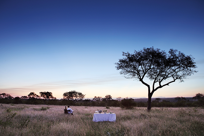 A honeymoon couple enjoy a sunset drinks stop. Elsa Young