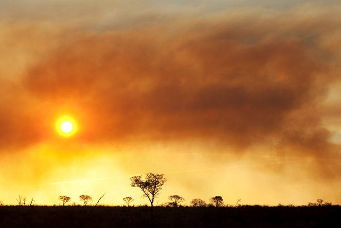A fire in the west helps to create a dramatic sunset. Amy A