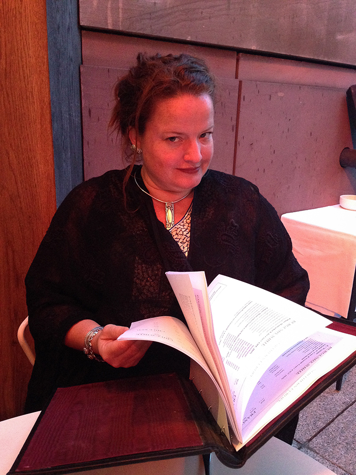 Anna inspecting the menu at Coq d'Argent