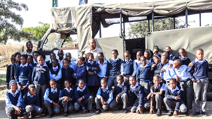 "The children of Tfolinhlanhla Primary School get ready for their first ever game drive with ""Kids in Parks"" Facilitator, Oriel Mhlongo (centre back). Of the 40 children who were part of this outing, not one had ever visited Kruger. Photograph by Accolade Ubisi"