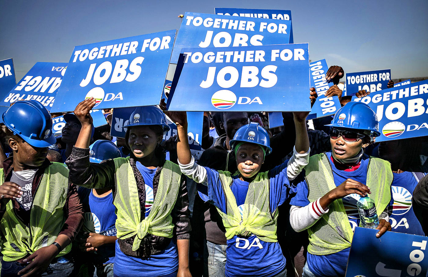 Supporters of the South African oppositi...Supporters of the South African opposition party Democratic Alliance (DA) holds signs as they gather in Mamelodi during an election rally on April 28, 2014. South Africa celebrated on the eve the 20th anniversary of its first ever all-race, democratic election that ended decades of sanctioned racial oppression under the apartheid system. This year's anniversary of democracy coincides with South Africa's fifth democratic election on May 7 where voters will cast ballots in a fiercely fought contest. AFP PHOTO/MARCO LONGARIMARCO LONGARI/AFP/Getty Images