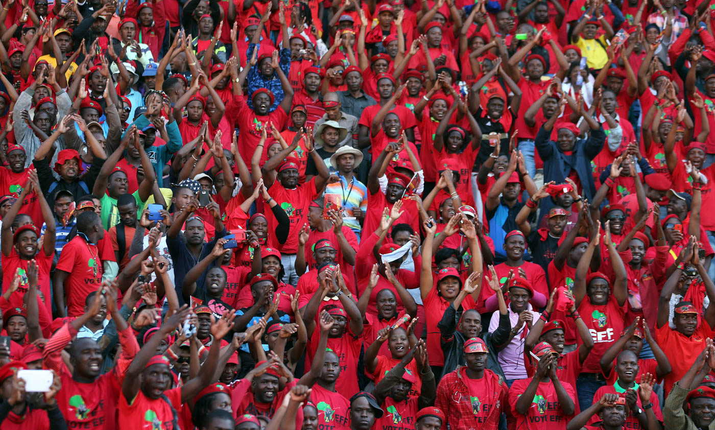 Economic Freedom Fighters (EFF) supporters sing during their election rally at Lucas Moripe stadium in Atteridgeville, west of Pretoria, South Africa, Sunday, May 4, 2014. South African political parties held final campaign rallies Sunday ahead of elections on Wednesday, May 7, 2014 that are likely to see the ruling ANC return to power with a smaller majority due to voters disaffected by corruption in government and economic inequality. (AP Photo/Themba Hadebe)