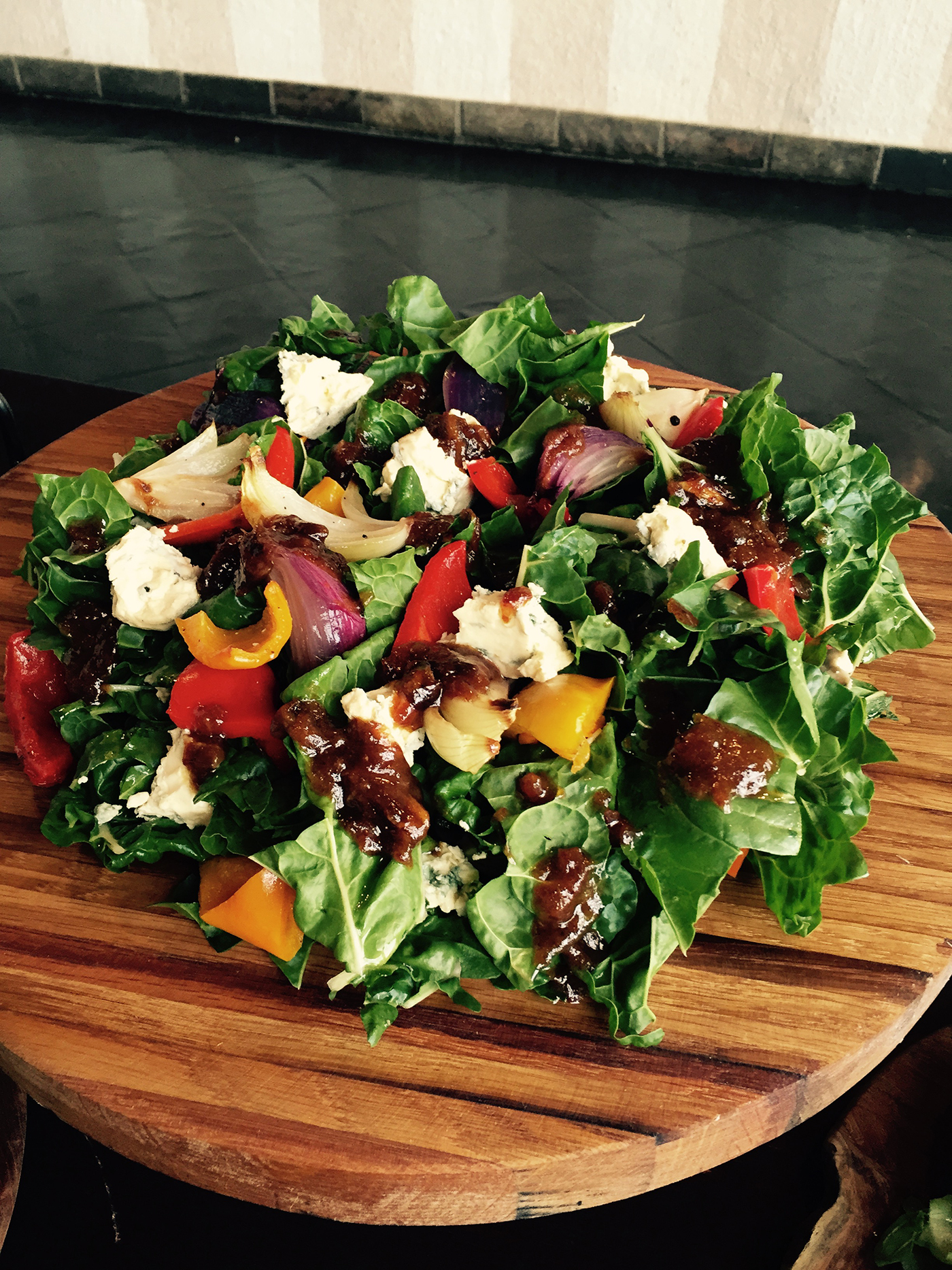 Spinach, creamy gorgonzola, roasted peppers and sweet roasted red onion salad with a date dressing.