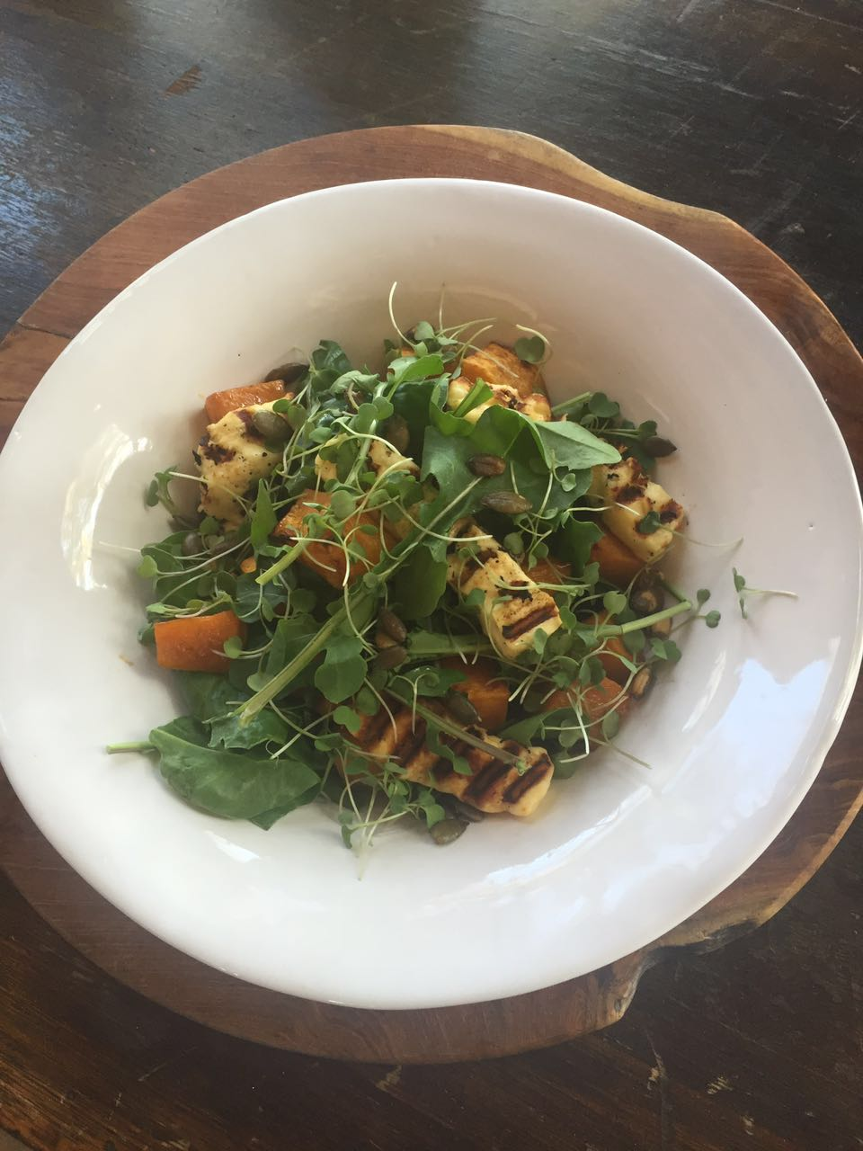 Spinach, rcoket and grilled haloumi salad with honey and cinnamon roasted butternut and crunchy pumpkin seeds.