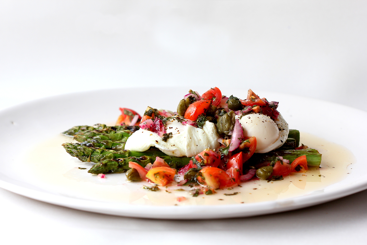 Chargrilled Fresh Asparagus with softly poached eggs, topped with a sauce vierge