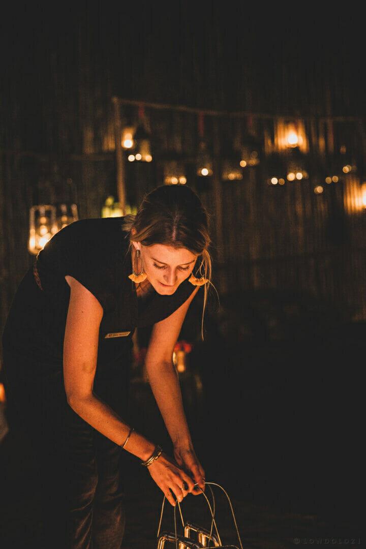 Lighting lanterns in Varty Boma