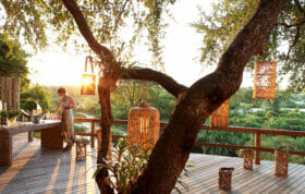 An Inn-keeper prepares for the evening at Londolozi Game Reserve - part of the Relais & Chateaux Africa family